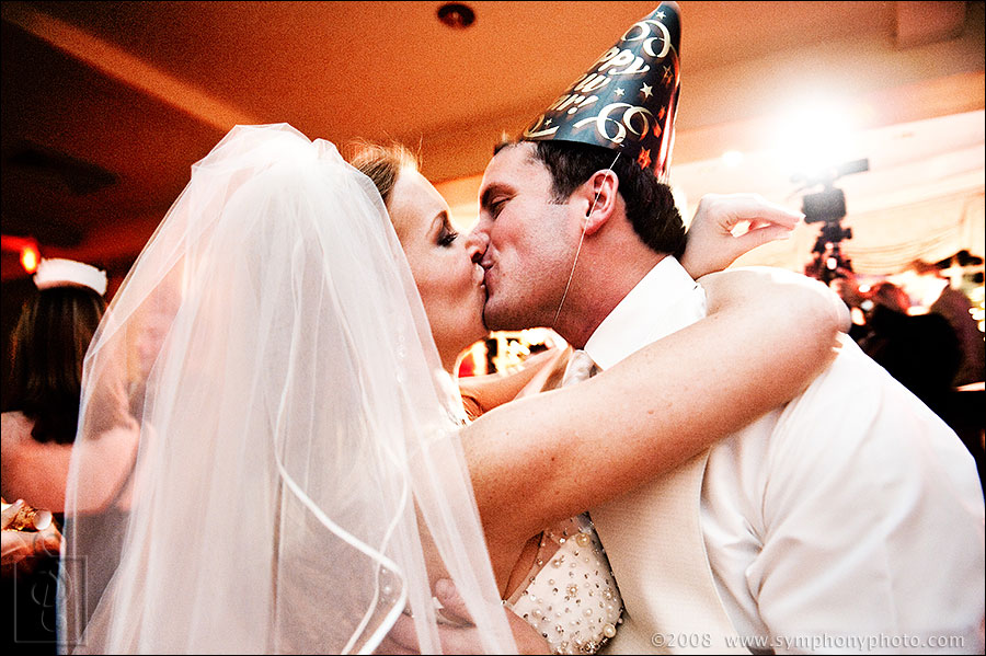 Bride and Groom kiss as the new year begins. Photo by Joe Ciarcia - Symphony Photography - Boston, MA