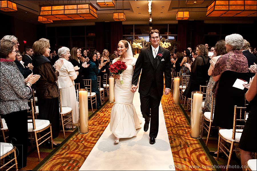 Bride and groom walk down the aisle at the Intercontinental Hotel in Boston, MA