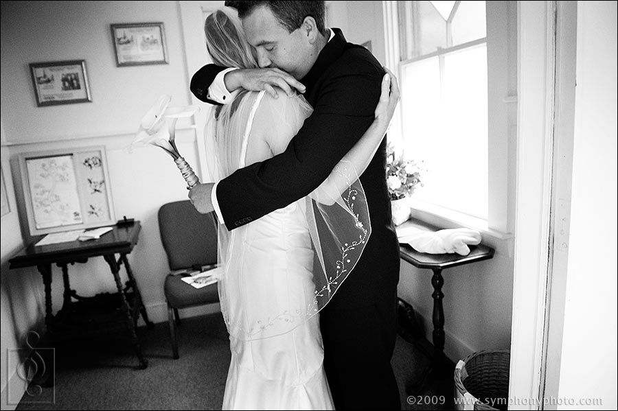 Bride and groom hug after the ceremony at the South Chatham Community Church in South Chatham, MA