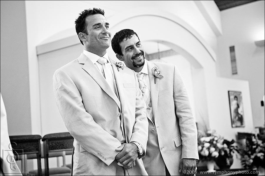 Groom and best man watching the bride walk down the aisle